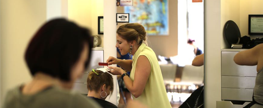 Dana Hunter styles hair and applies hair color at Alter EGO Salon and Blow Dry Bar in downtown Raleigh.