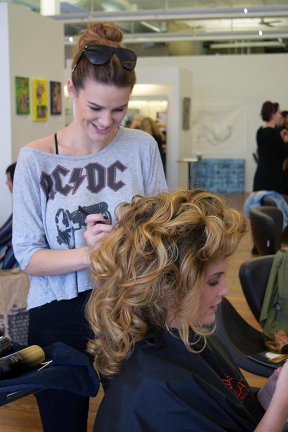 Aspen Johnson creates bouncy curls at Alter EGO Hair Salon in downtown Raleigh.
