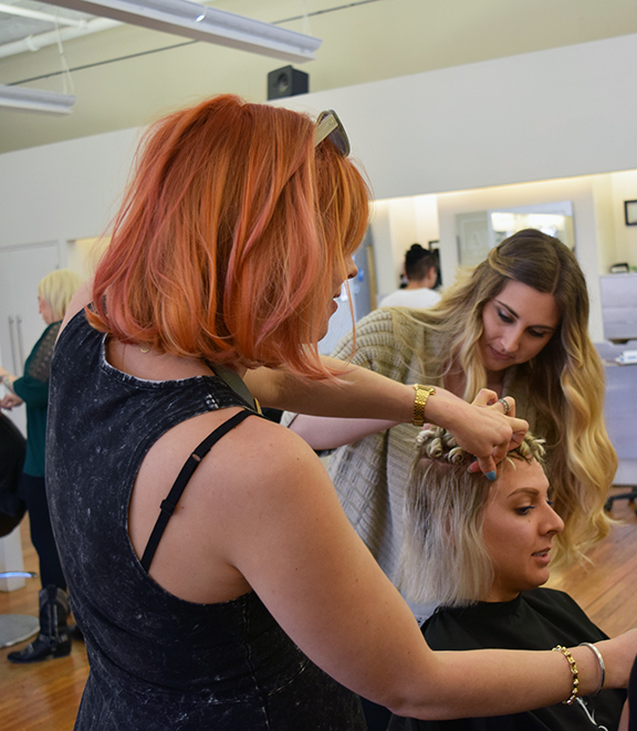 Dana Rosa and Shayla Moreira create formal hair styles at Alter EGO Hair Salon in Downtown Raleigh.