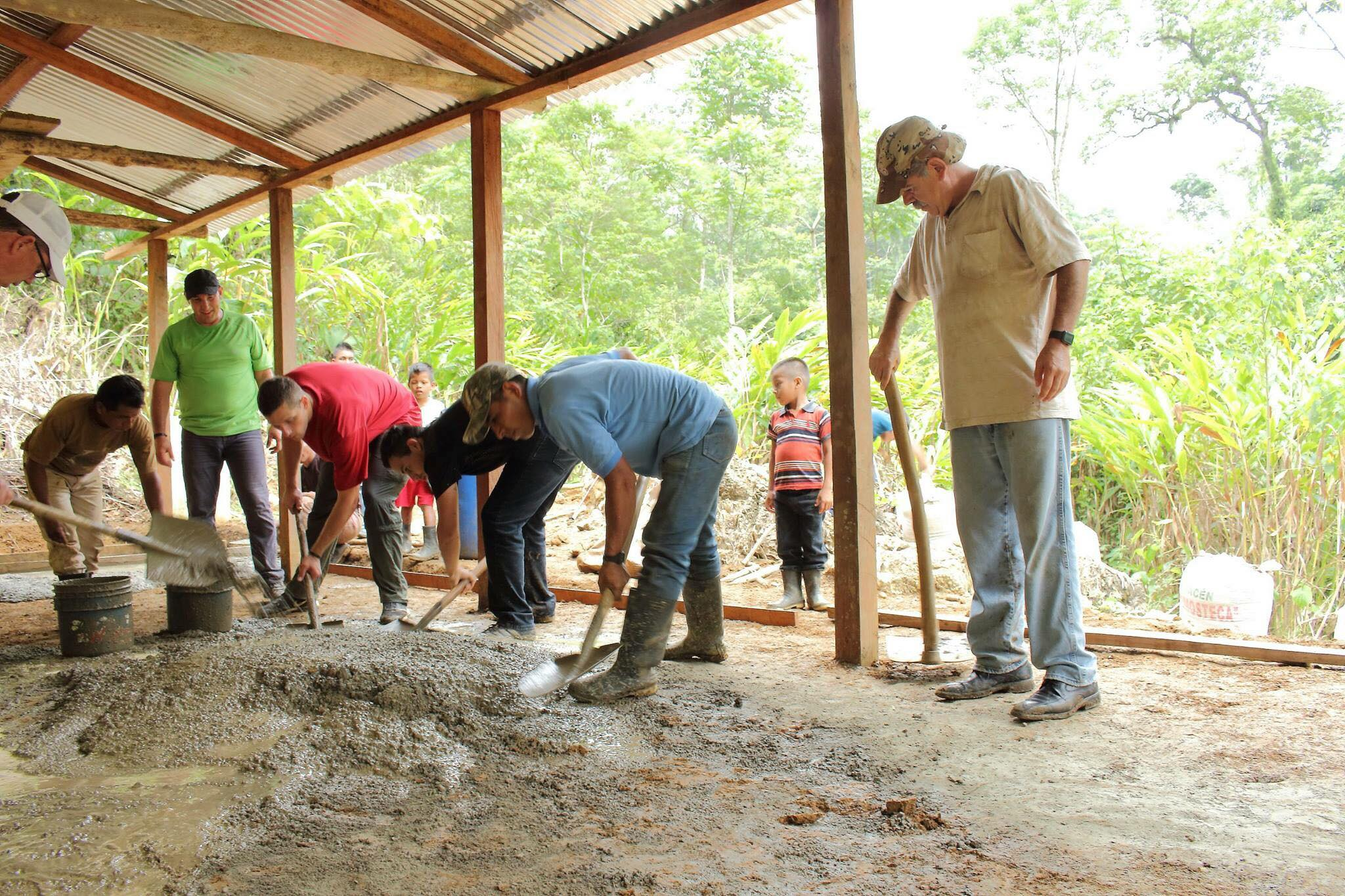 The volunteers along with members of the village hard at work, to build the school's foundation.