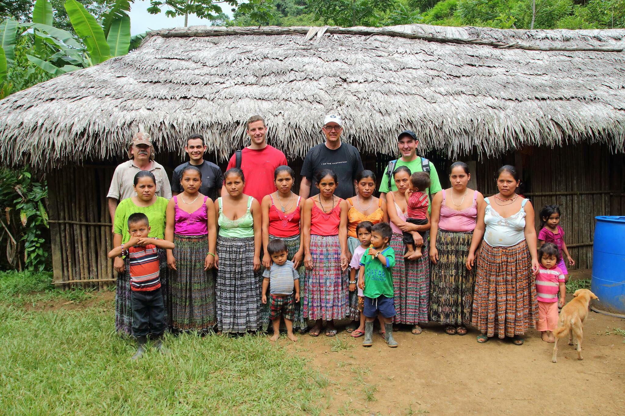 Our volunteers in front of the old school house with a group of mothers from the village.