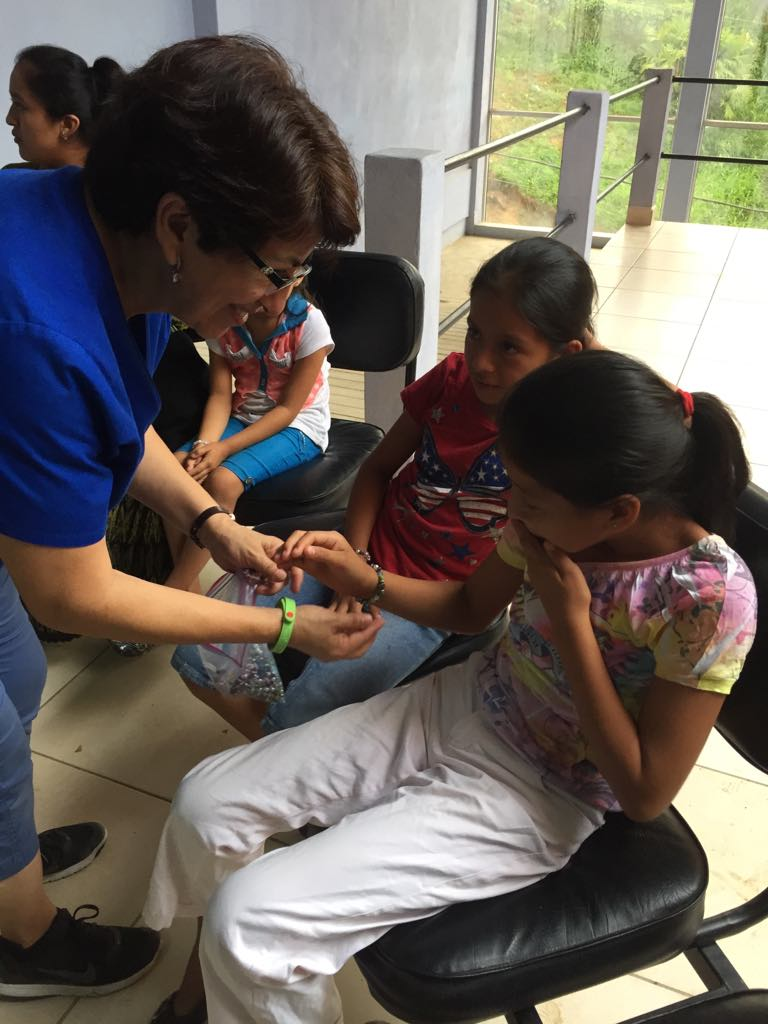 Ileana giving out bracelets that our friends from Fresno, California.