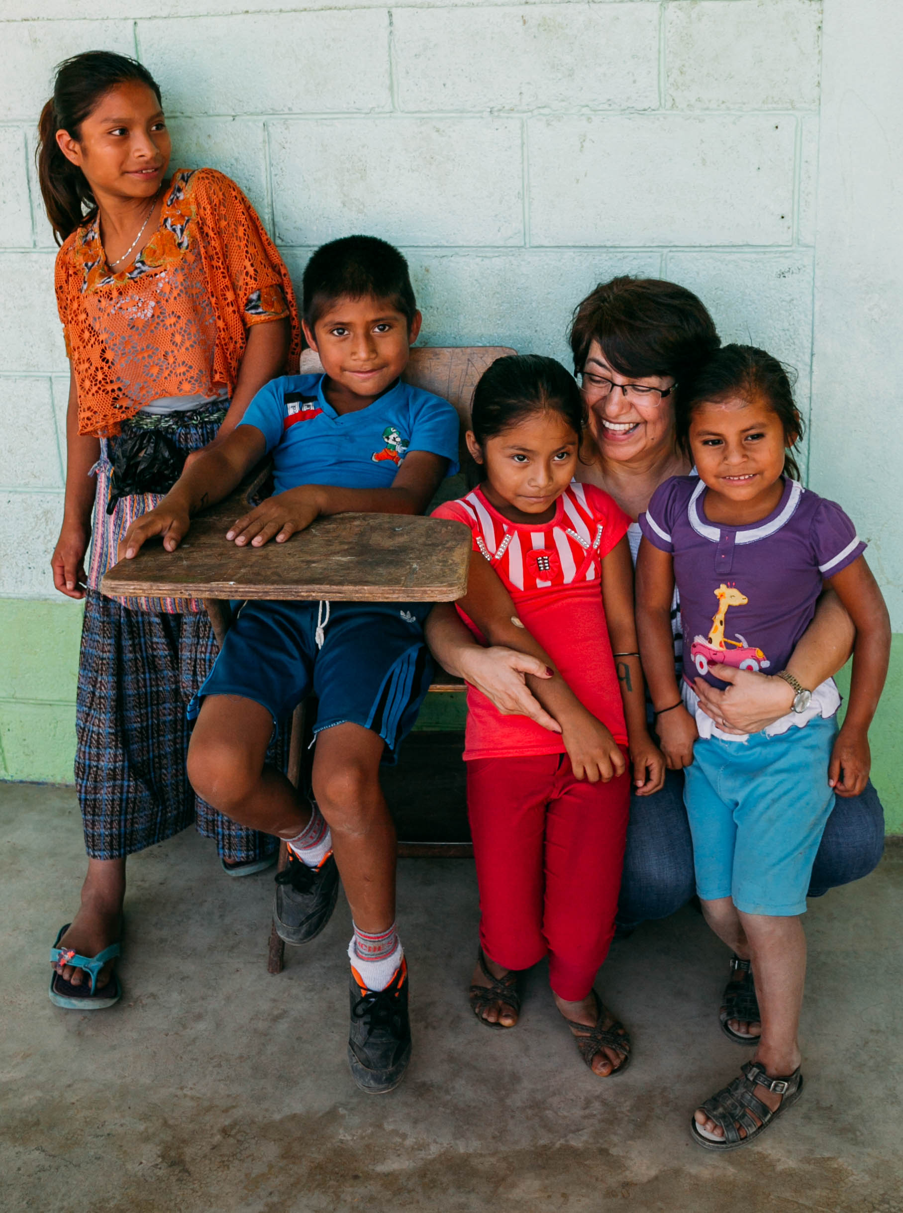 kids waiting outside the dental clinics for their parents with one of our board members, ileana.