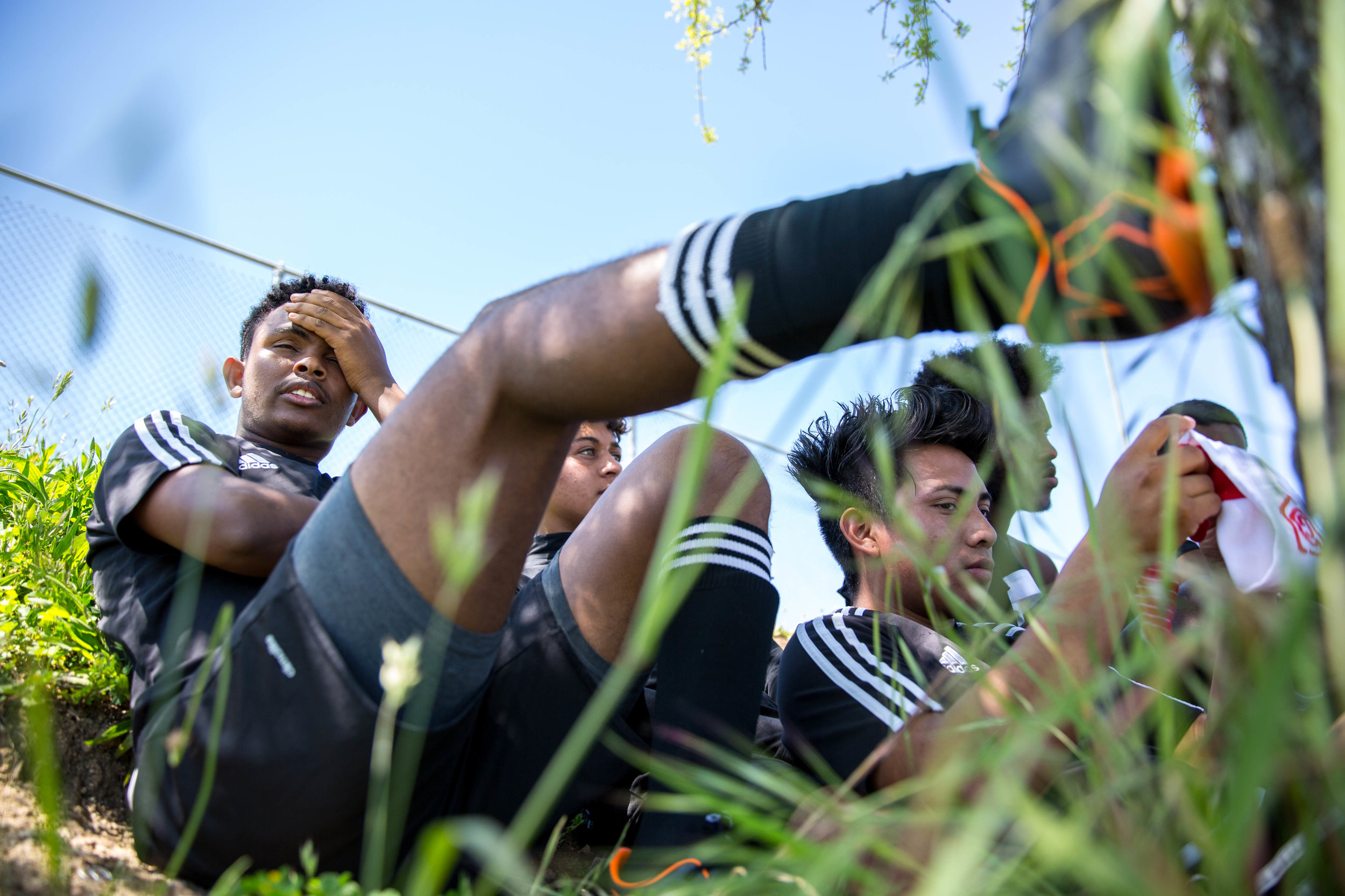 Originally from Eritrea, Africa, Oakland International High School senior Merhawi Beyene rests after a soccer game on Saturday, April, 14, 2018.