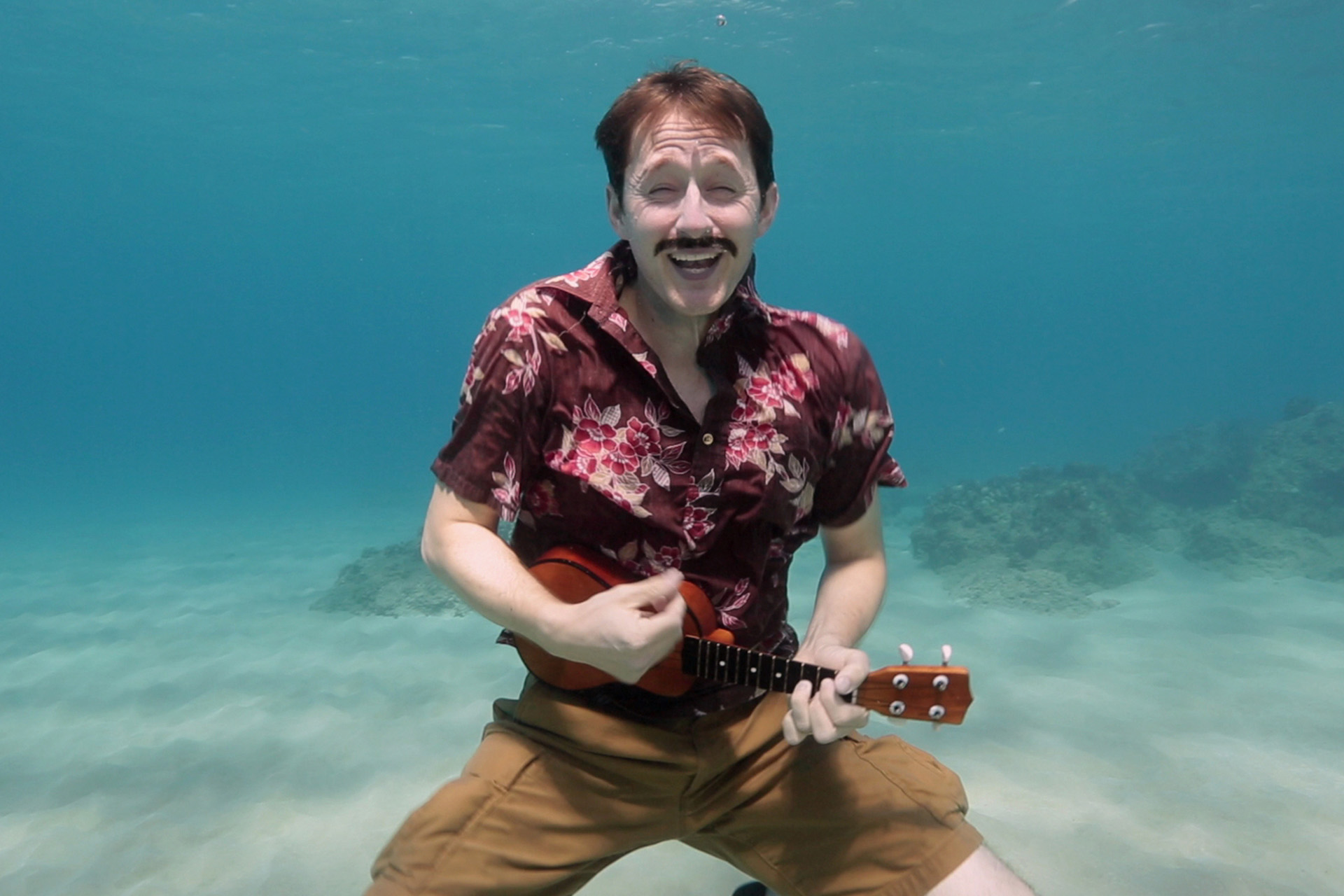 Robert Sams sings The Marine National Monuments Song with his ukelele underwater.