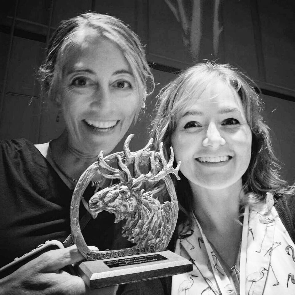 Stephani Gordon and Laura Sams hold their award for Best Youth Engagement at the Jackson Hole Wildlife Film Festival.