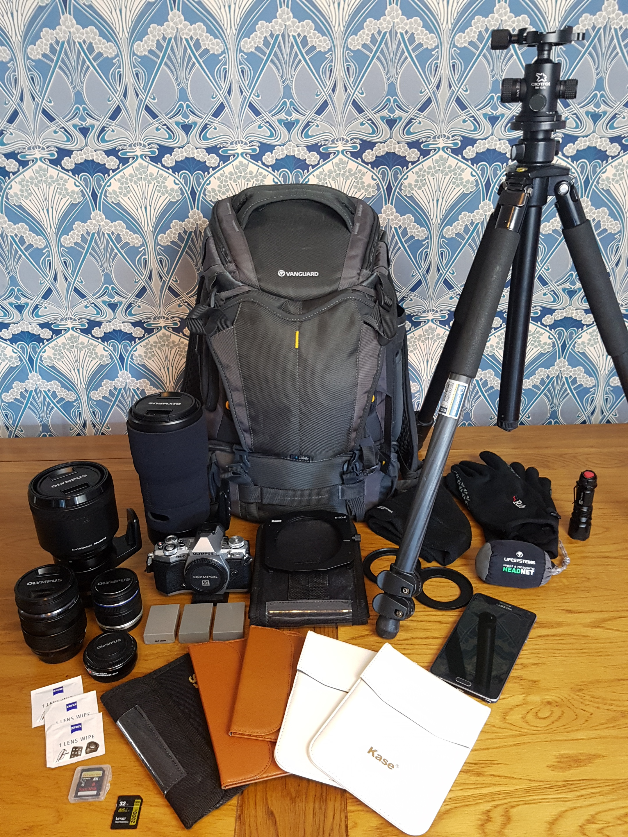 - Camera- Olympus OMD Em5 mk2Lenses - Olympus 9-18mm        Olympus 12-40mm 2.8 pro        Olympus 40-150mm 2.8 pro        Olympus 300mm f.4 pro        Olympus x1.4 teleconverterFilter Kit - Kase K100-x holder and polarizer, Range of ND Graduated filters, range of full ND filtersSpare BatteriesLens wipesSpare memory cardsMobile PhoneHat, gloves and headnettorchGiottos tripod and ball head