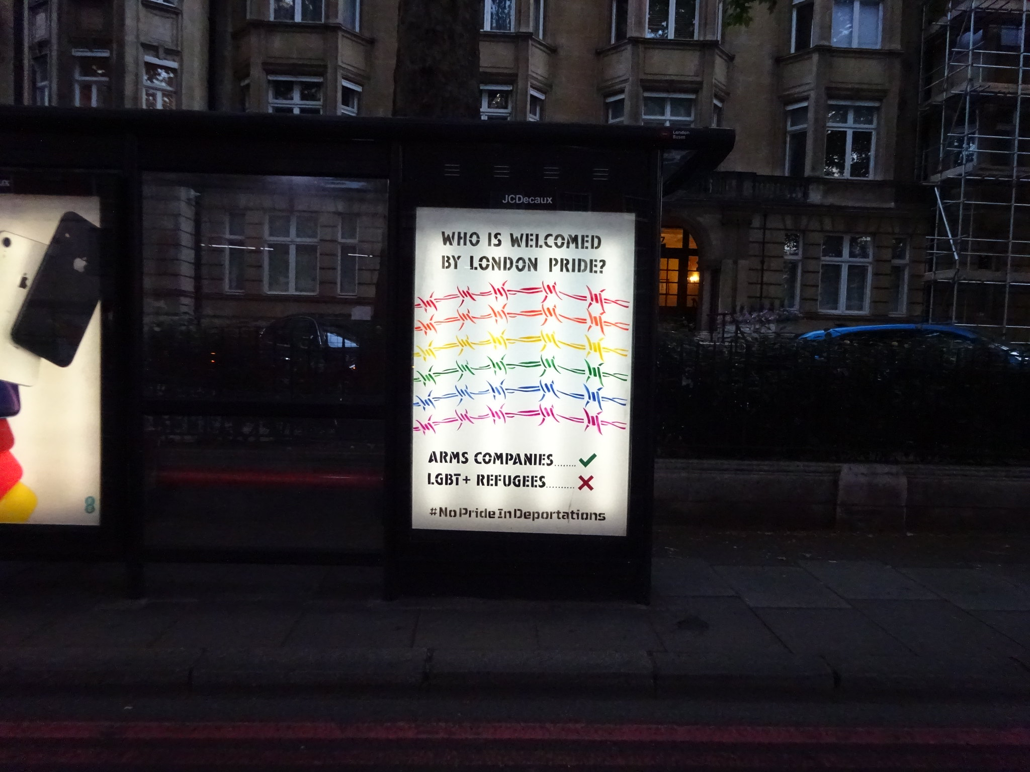 Bus stop adhack by Lesbians and Gays Support the Migrants and Protest Stencil protesting the exclusion of LGBT+ asylum seekers, homeless people and community groups from Pride in London5