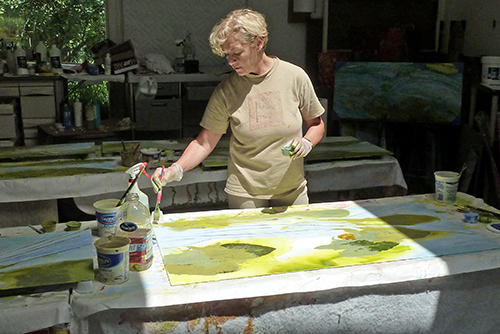 Vicki Junkwright color washing panels in the studio