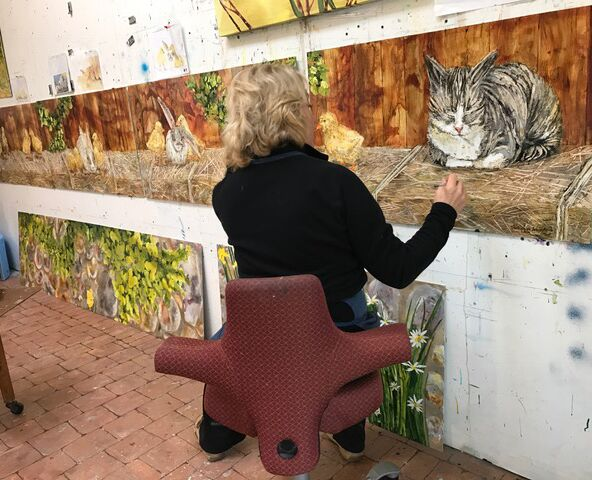 Vicki Junkwright fine tuning panels in the studio