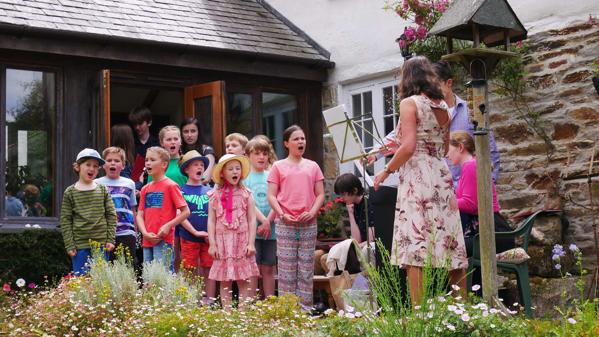 Cornwall Junior Choir in performance at Brackenwoods Open Garden in June under the direction of their then director, Christine Judge.