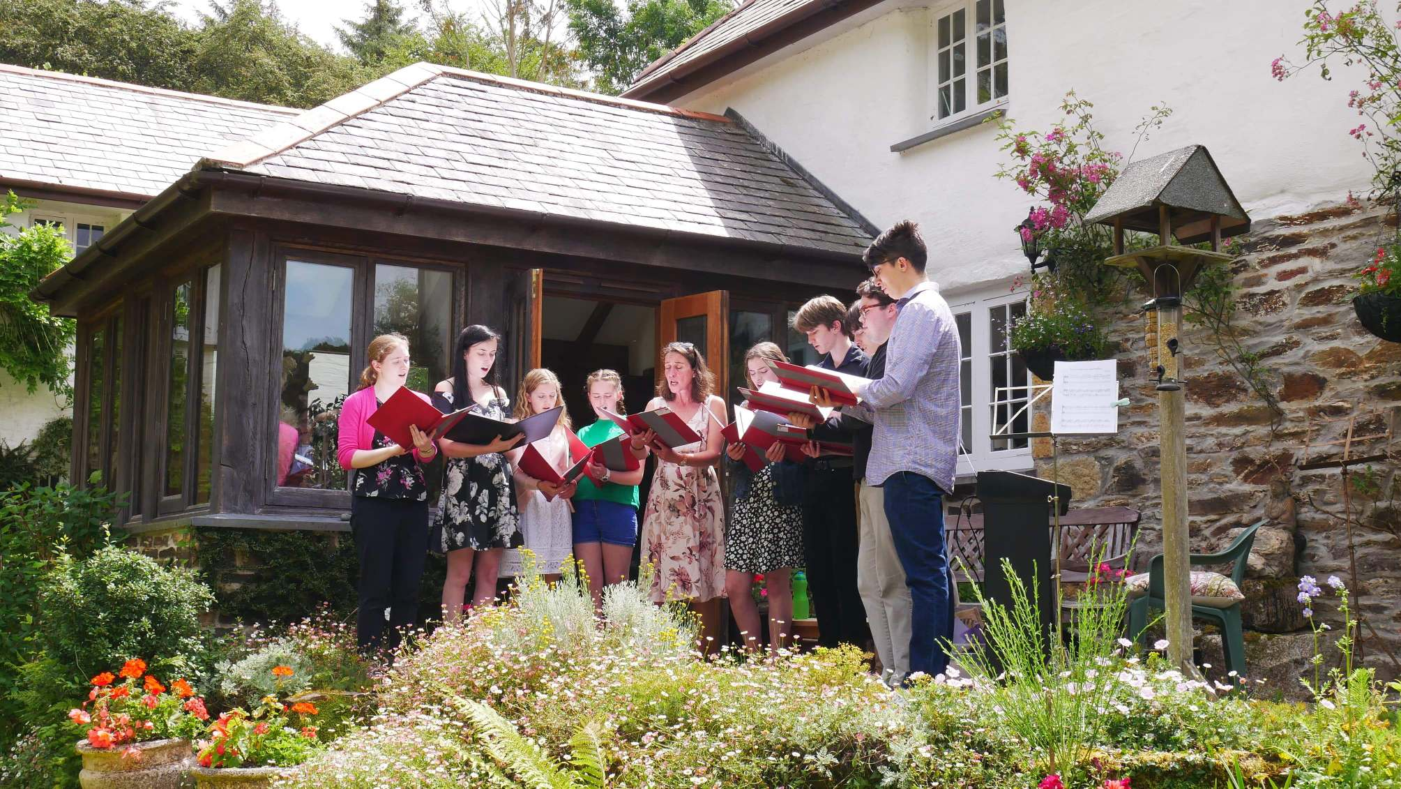 Cornwall Youth Chamber Choir in performance at Brackenwoods Open Garden in June under the direction of their director, Christine Judge.