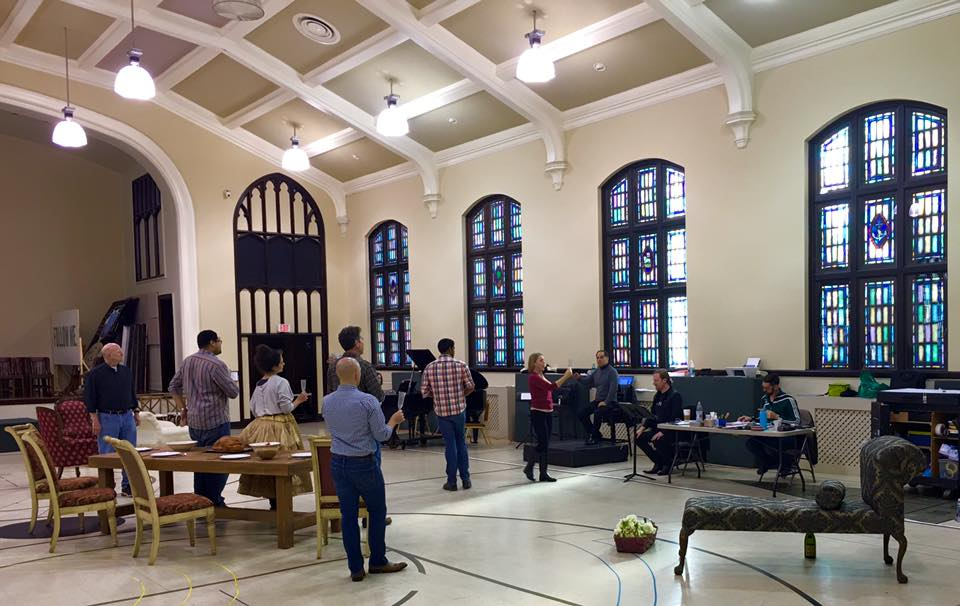 Members of Opera Carolina rehearsing La Traviata in the First Methodist gym.