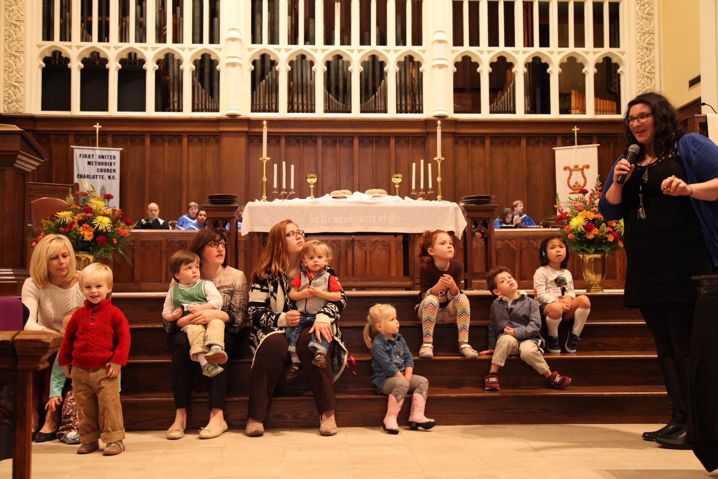 """Family and Outreach Minister Kelly McRell leading the kids in a """"Children's Moment"""" during the 11:00 a.m. Sunday worship service."""