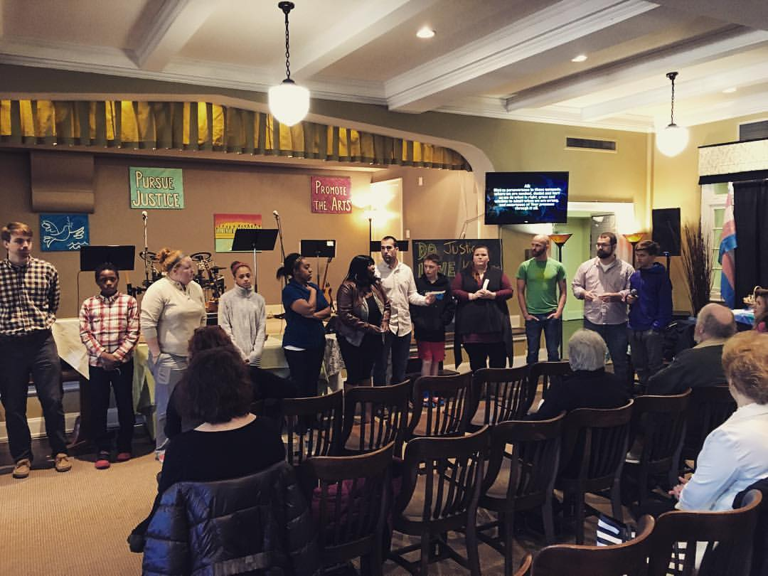"""Youth and young adults facilitating a liturgy based on the Beatitudes during the 9:00 a.m. Sunday """"Connect"""" service."""