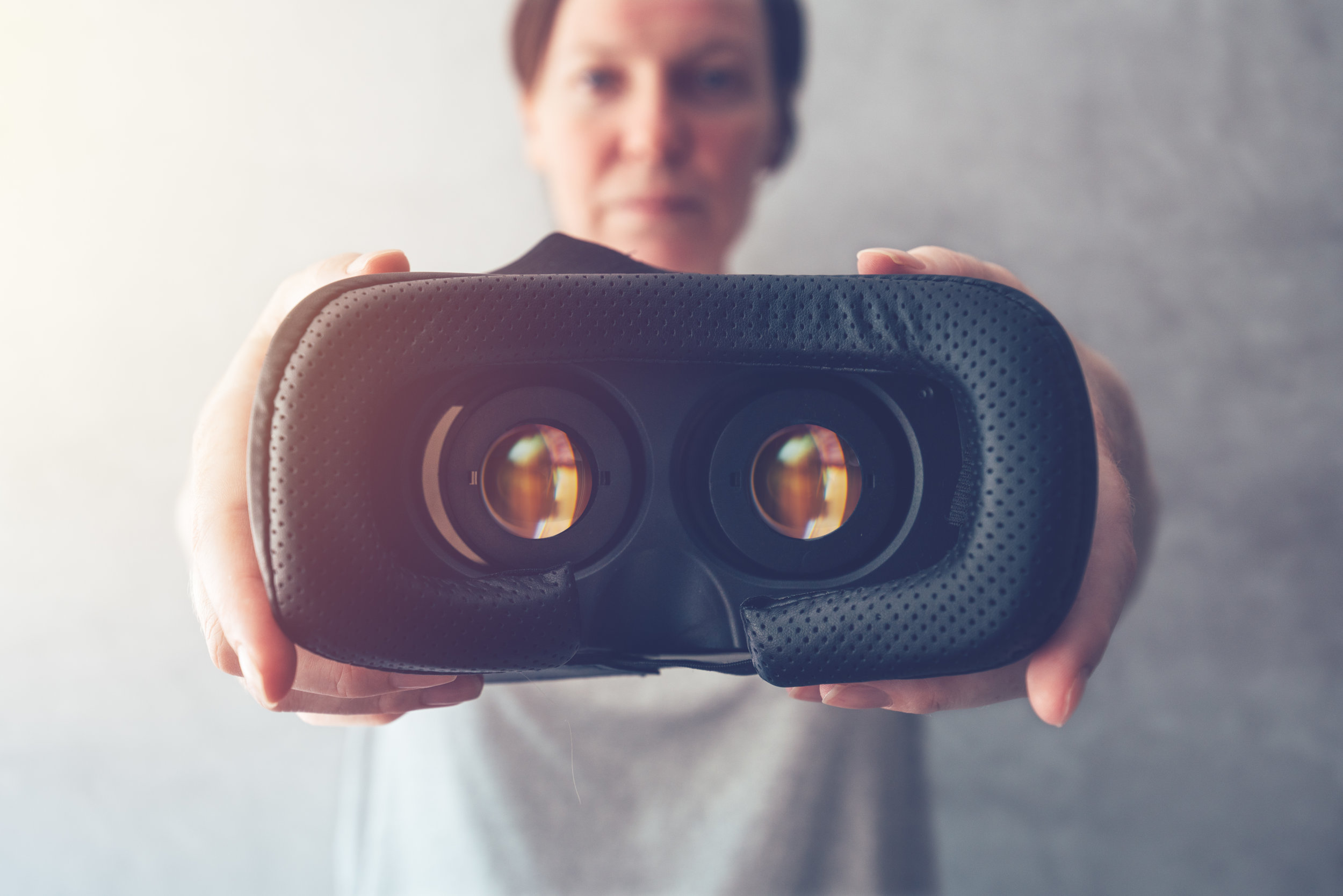woman-offering-vr-headset-BXEKQ7C.jpg