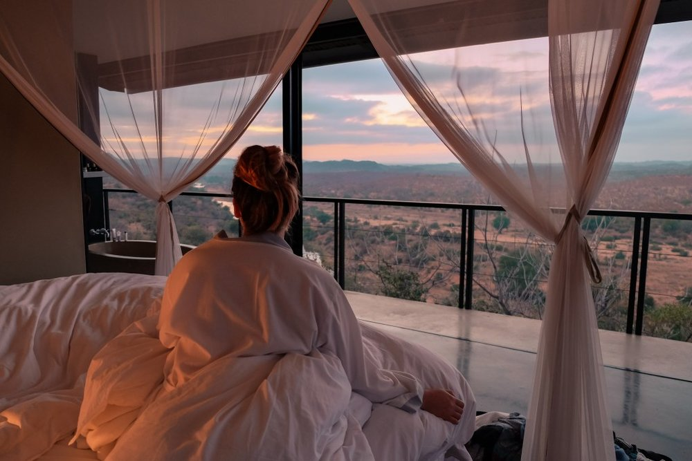 @tailsofamermaid     waking up with a view and a hot cup of tea before her morning game drive. The uninterrupted, panoramic views from our luxury spaces are one of the most special things about our spot up on the hill.