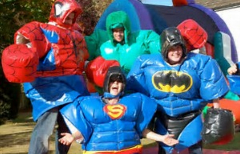 Brand New!!Superheroes Sumo Suitsfor ages 8 - small adult Comes in a set of 4 -