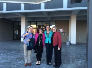 Oklahoma Arts Council staffers Joshua Lundsford, Whitney Cross Moore and Amy Weaver with OFTA Director Julia Kirt (blue jacket)