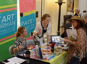 Nicole Poole and Erinn Gavaghan representing the Norman Arts Council at Arts Day 2014