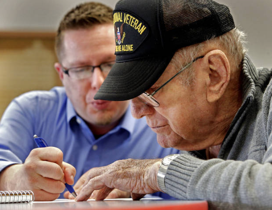 Jason Poudrier, a decorated Iraqi War vet, works with Bill O'Pecko, Air Force veteran, as he leads creative writing classes at the Norman Veterans Center.      Photo by Steve Sisney, The Oklahoman