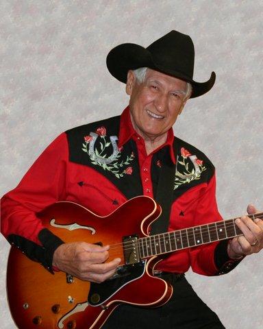 Les Gilliam pickin' away at his guitar.