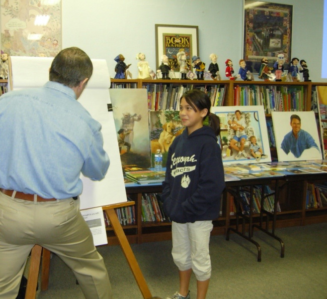 Mike Wimmer demonstrating drawing techniques at Sequoyah Elementary