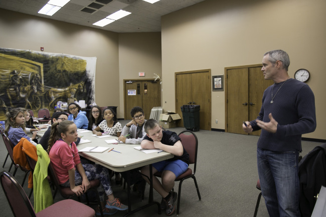 2013-14 Poet Laureate Dr. Nathan Brown speaking with students at the Writing in Response to Art program.