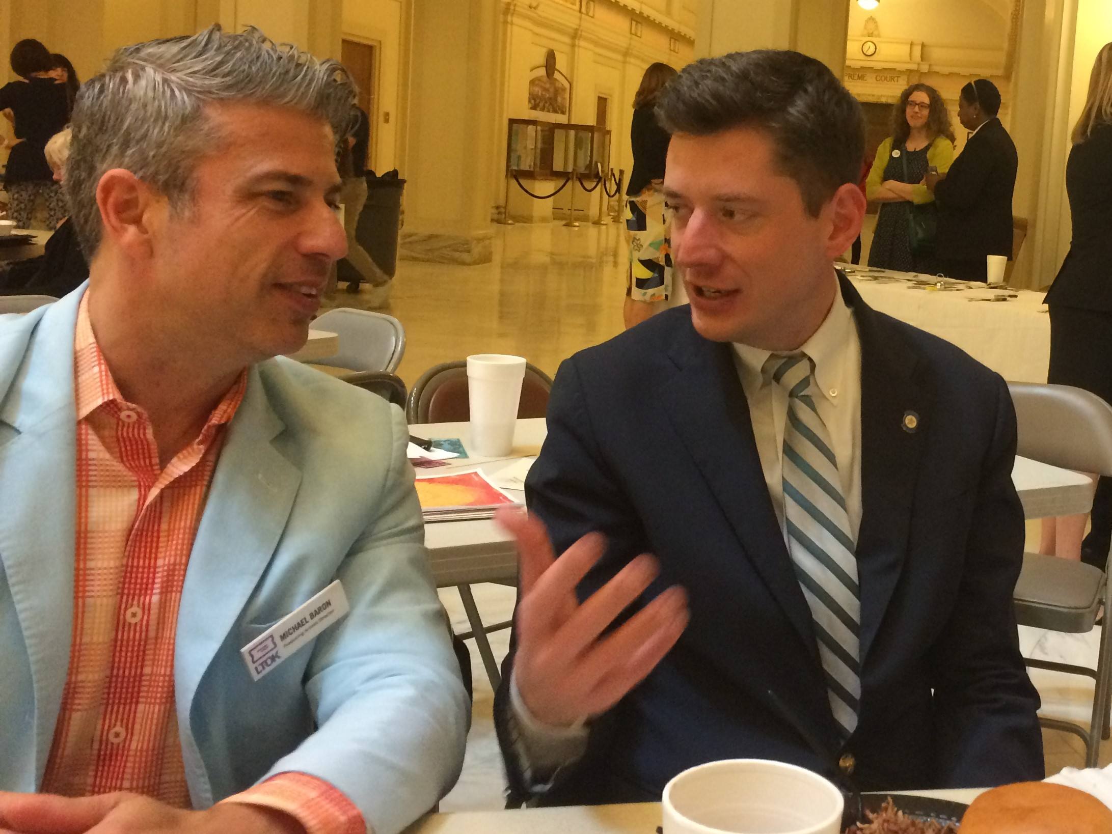 Michael Baron, Artistic Director of Lyric Theatre, talks with Senator David Holt (now Mayor Holt) at Arts Day in 2017.