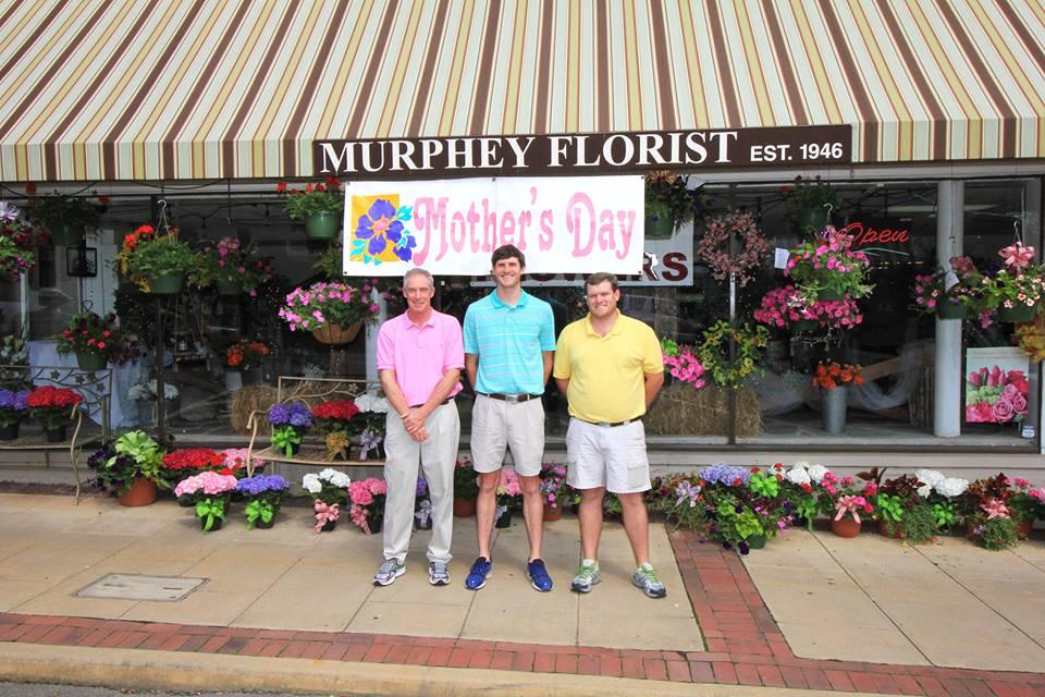 The Murphey boys. Hutch Murphey, Sr., Mac Murphey, & Hutch Murphey, Jr. outside of Murphey Florist in Downtown Newnan.