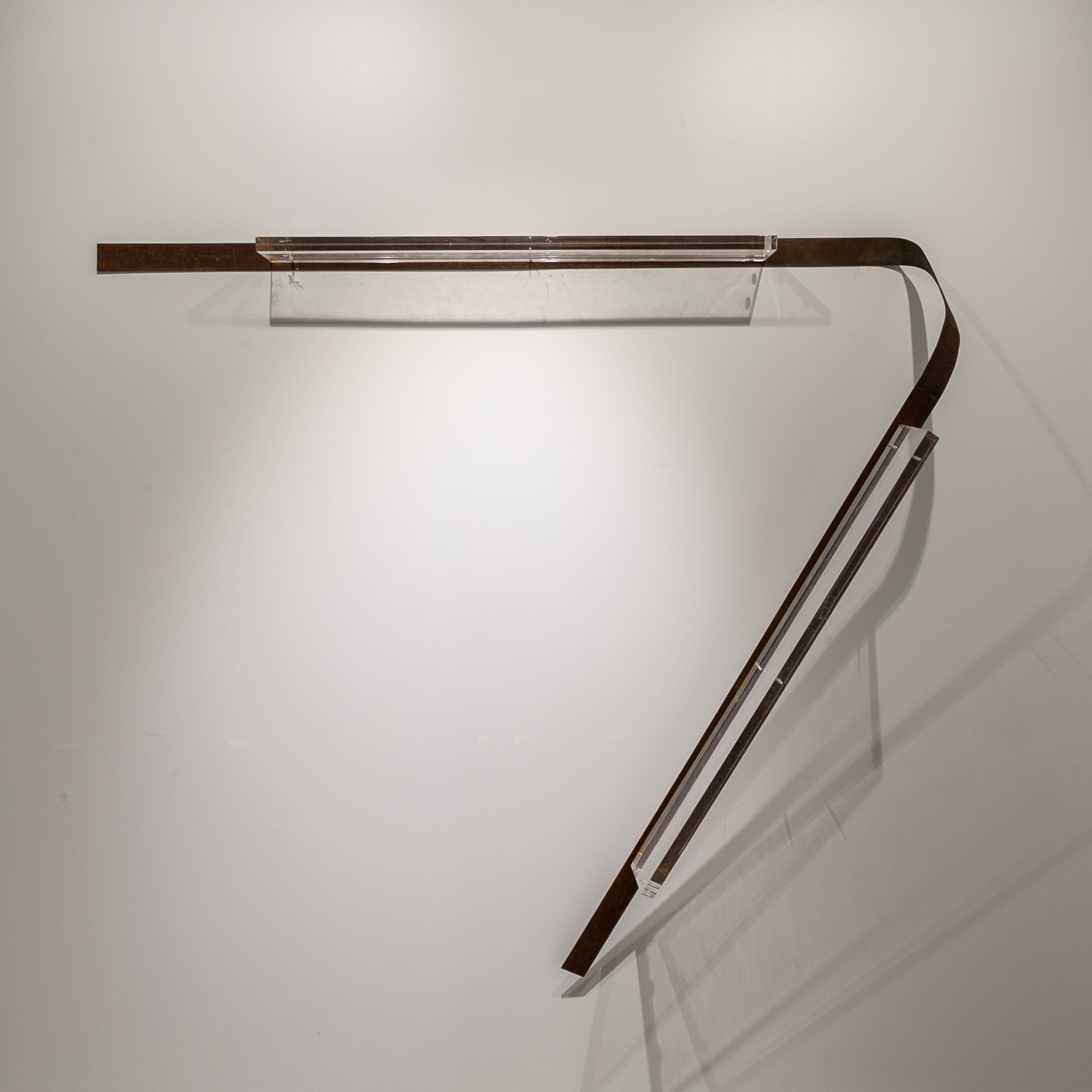 "Tracy Treadwell (Memphis, TN)   An Avenue , 2018  Medium: Steel strap and Lucite shelves  Dimensions: 60x 68x12 inches   ""Tracy Treadwell's work bridges the familiar and the suggestive through assemblage of found and fabricated objects and through her exploration of memory as it fades and evolves over time. In an attempt to decipher and acknowledge her own history, Treadwell taps into the pathways that determine a variety of relationships: how object mass relates to body mass, how materials extend themselves to the human anatomy, and how color, object, and space trigger memory.""  (Artist Statement)"