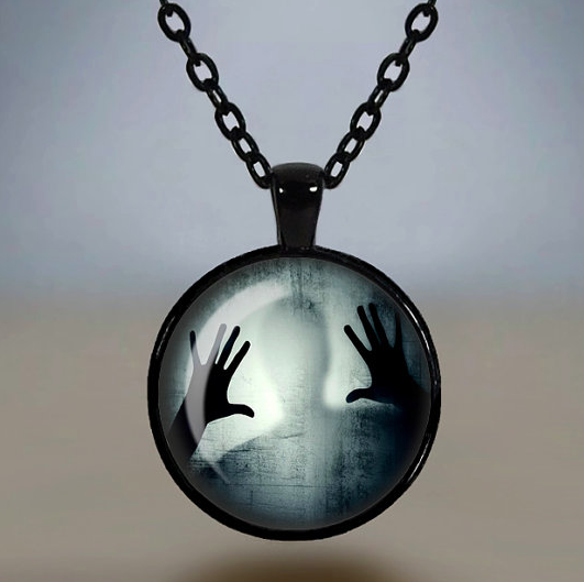 LB - Image - Horror Lounge - Merch - Spooky Man Behind Glass Necklace Glass .png