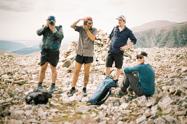 Friends around the rock cairn and everybody's Rocky Mountain high.       📸 Minolta X-700 on Fuji C200 🎞