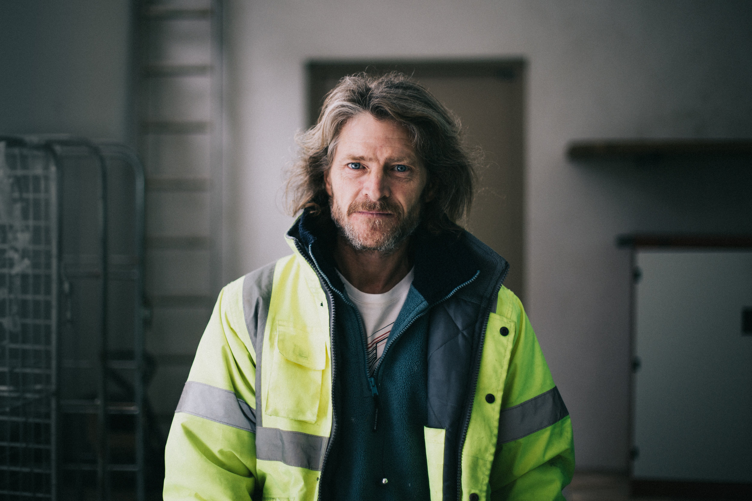 Carpenter Paul, a former soldier, stands at Falmouth University's Penryn Campus where he now works doing maintenance jobs.