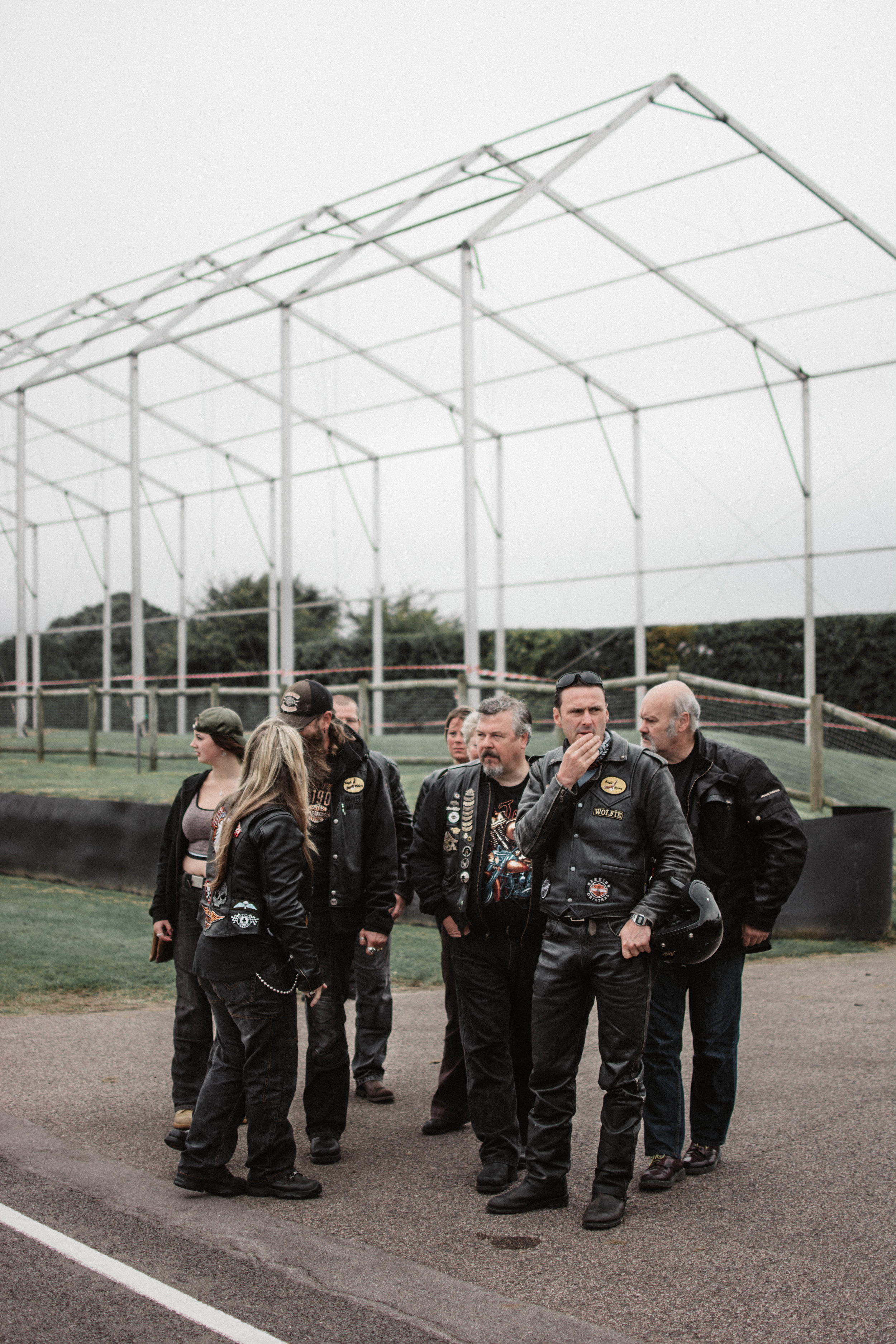 A group of bikers at Goodwood Racecourse's Breakfast Club: A showcase of classic vehicles owned by members across the country.