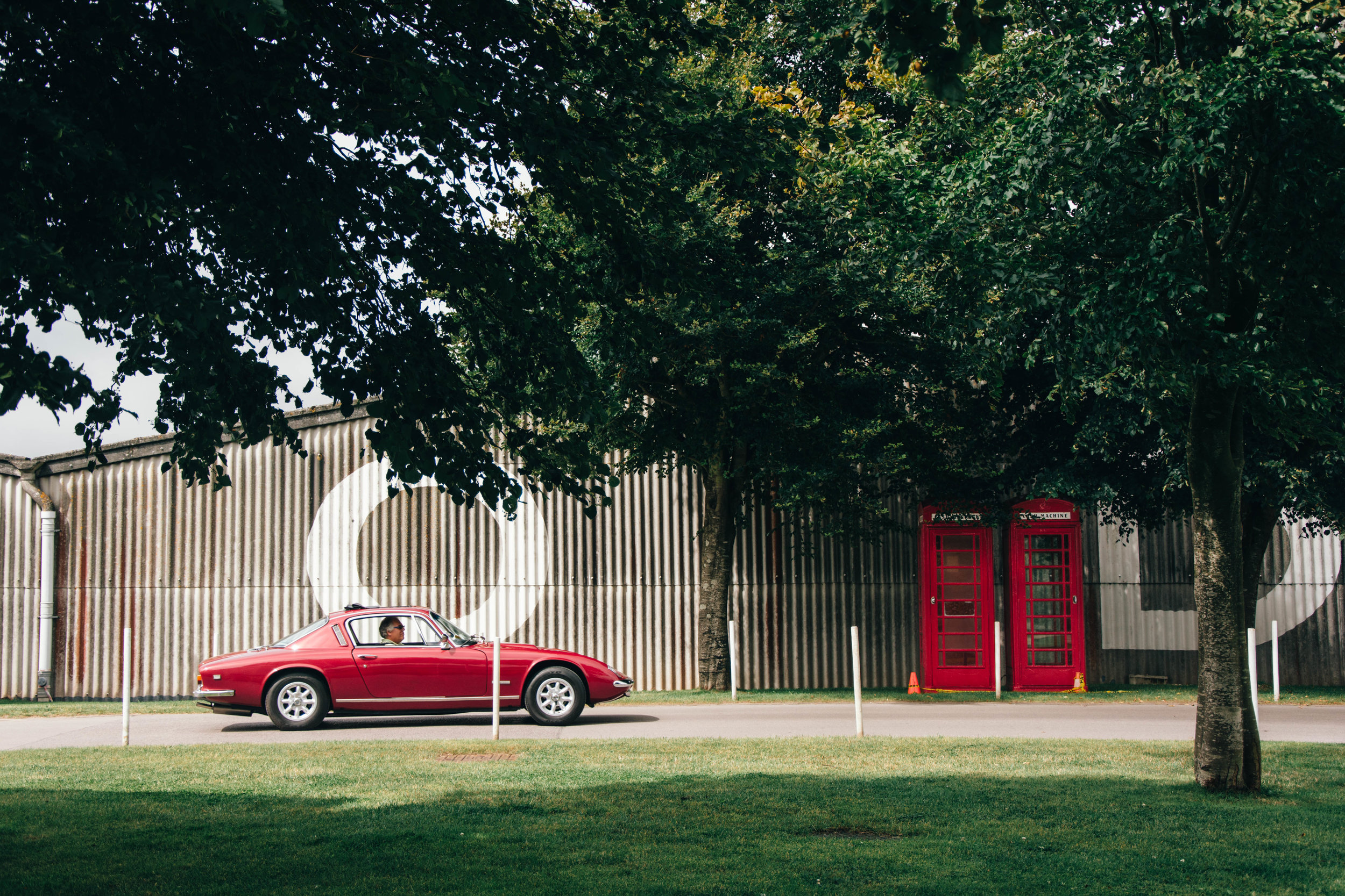 A Goodwood member leaves the Breakfast Club meeting in his classic sports car.
