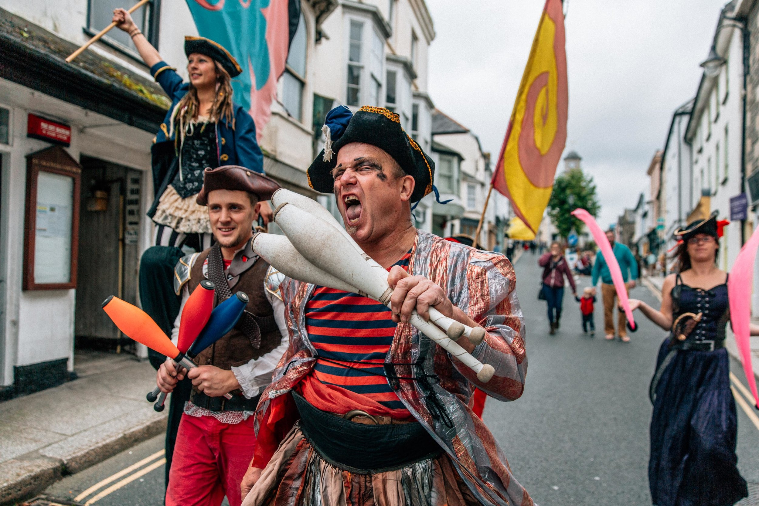 A group dressed as Cornish Pirates march down Penryn high-street to the start of the Penryn Kemeneth procession. Kemeneth is an annual two-day community heritage festival. Penryn, Cornwall, UK. 14th Oct 2017.