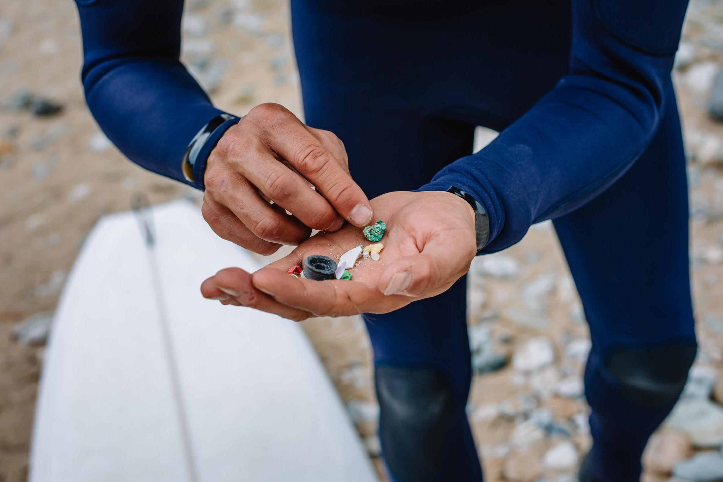 Hugo Tagholm, Chief Executive of Surfers Against Sewage, holds pieces of plastic pollution and other litter picked up at Porthtowan Beach. St Agnes, Cornwall, UK. 29th May 2018.