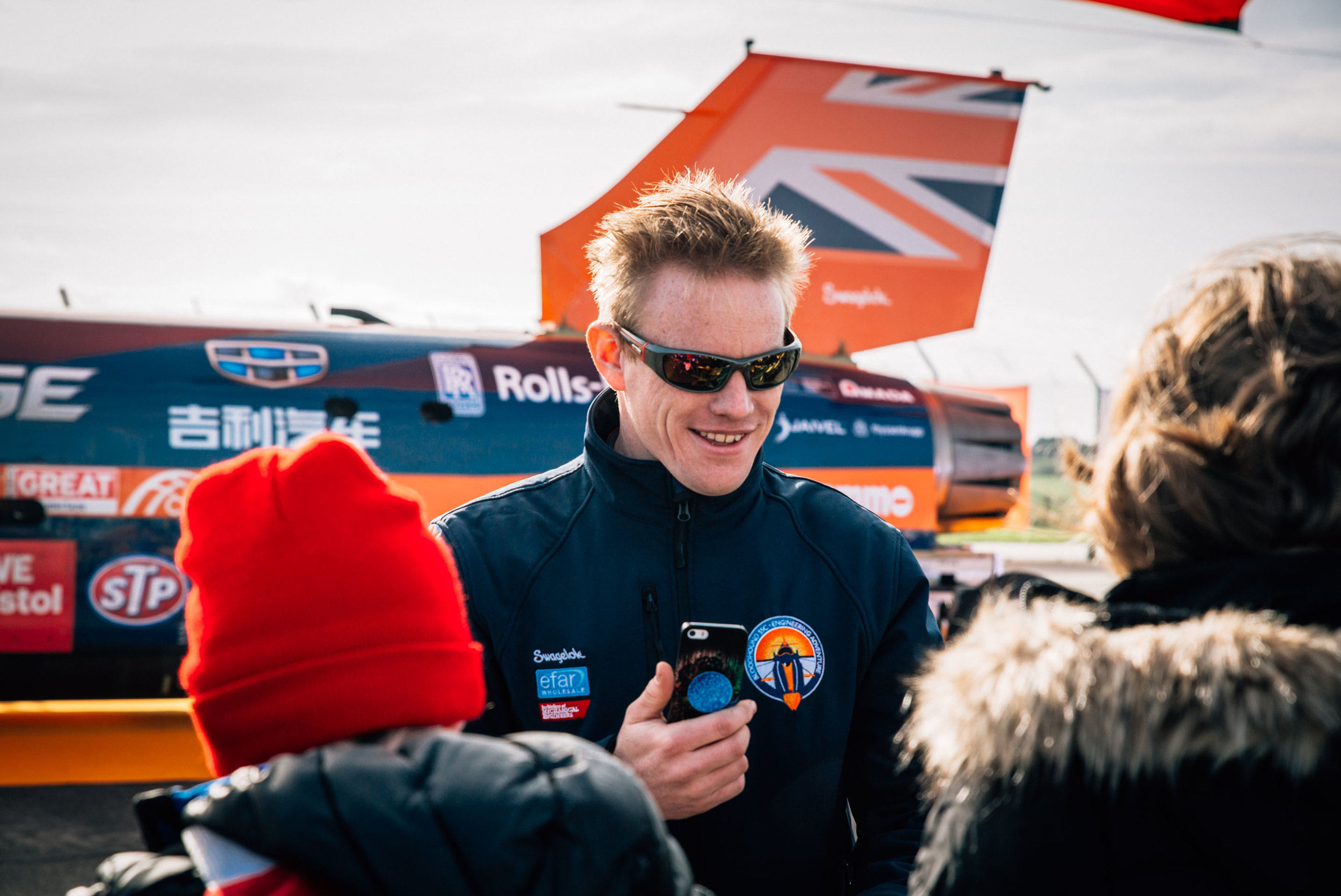 A member of the Bloodhound Supersonic Car team speaks with children visiting as part of the Cornwall Skills Show at Newquay Airport. Newquay, Cornwall, UK. 30th Oct 2017.