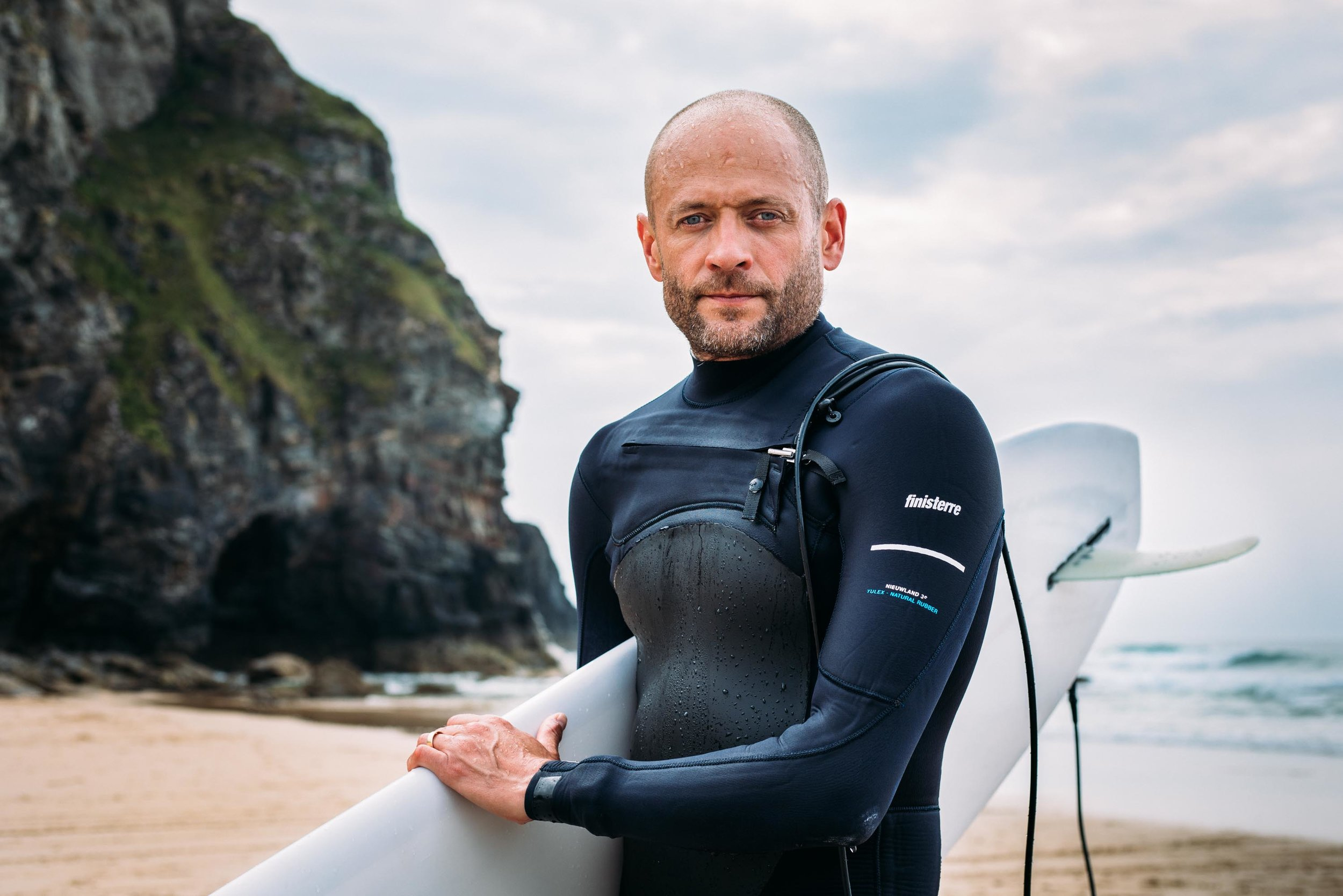 Chief Executive of Surfers Against Sewage, Hugo Tagholm after a surf at Porthtowan Beach, St Agnes, Cornwall, UK. 29th May 2018.