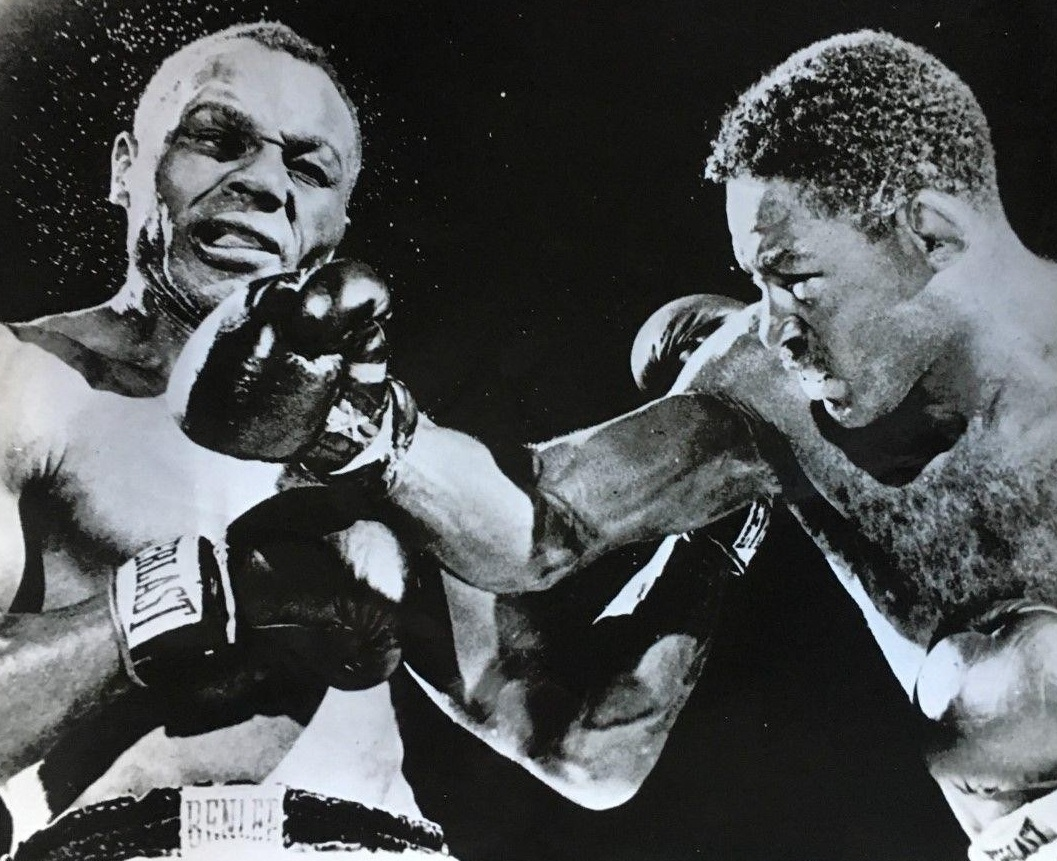 Ezzard Charles on the right delivering a blow to challenger Jersey Joe Walcott