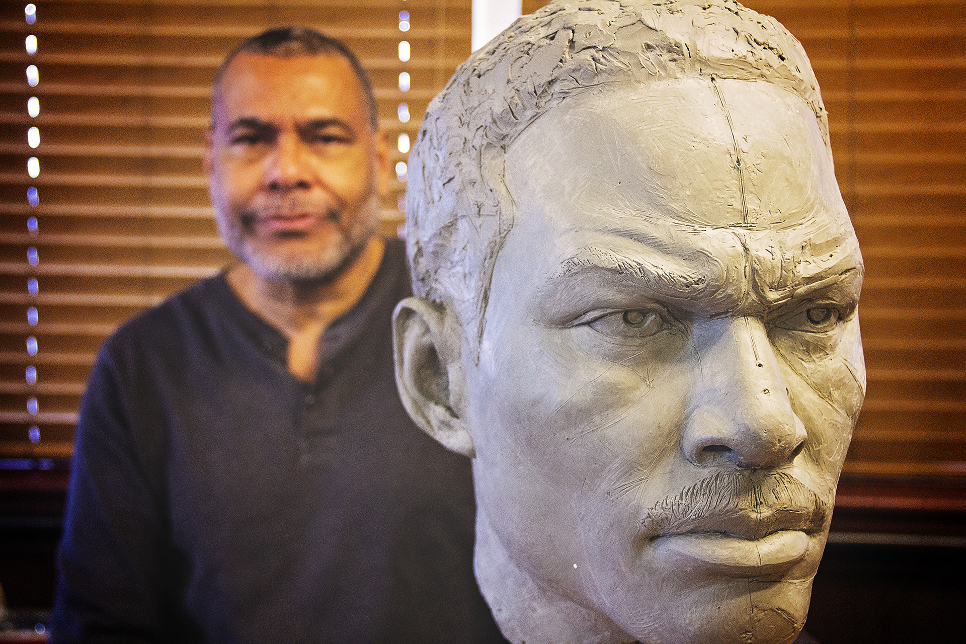 Ezzard Charles II with the in-process bust of his father, photo by Kailah Ware
