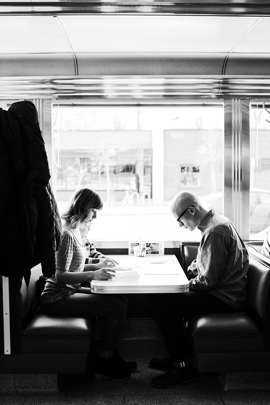 Diners reading a menu in a booth | Hi-Lo Diner | The Restaurant Project