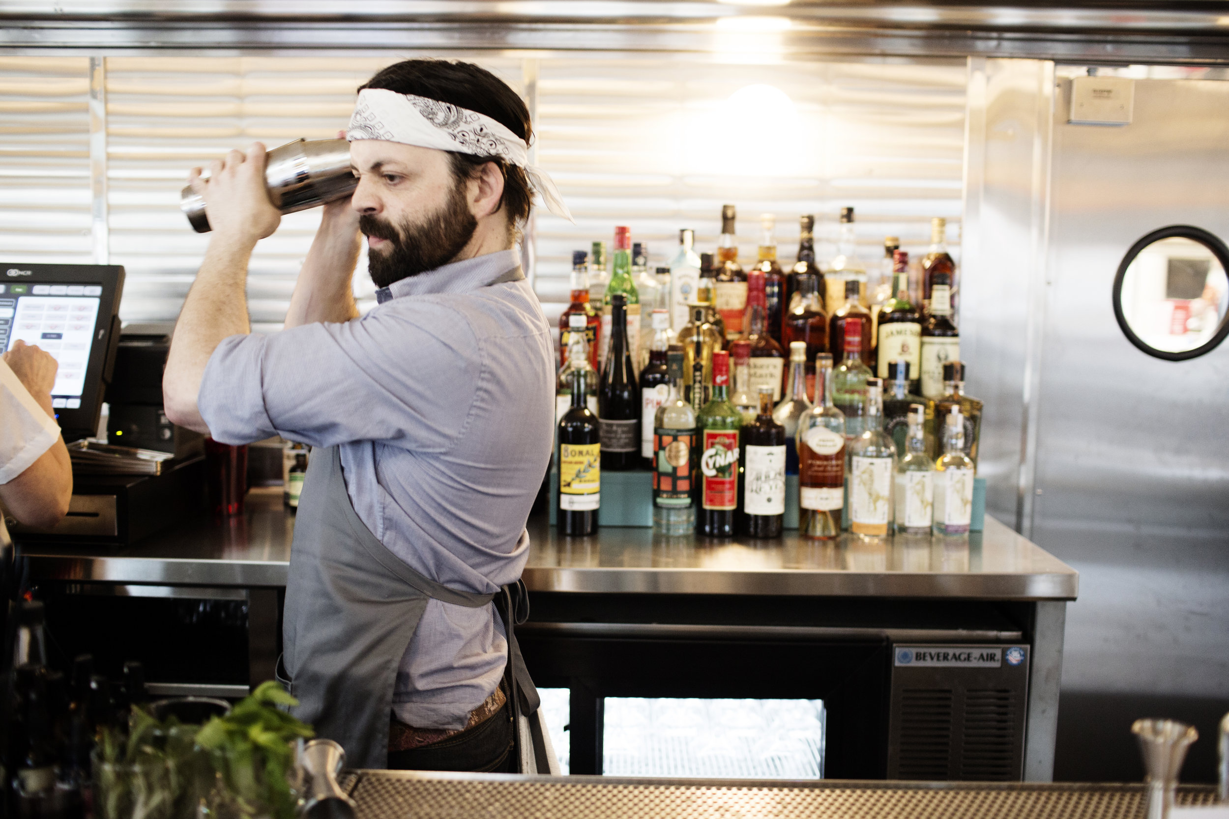 A bartender making a cocktail | Hi-Lo Diner | The Restaurant Project