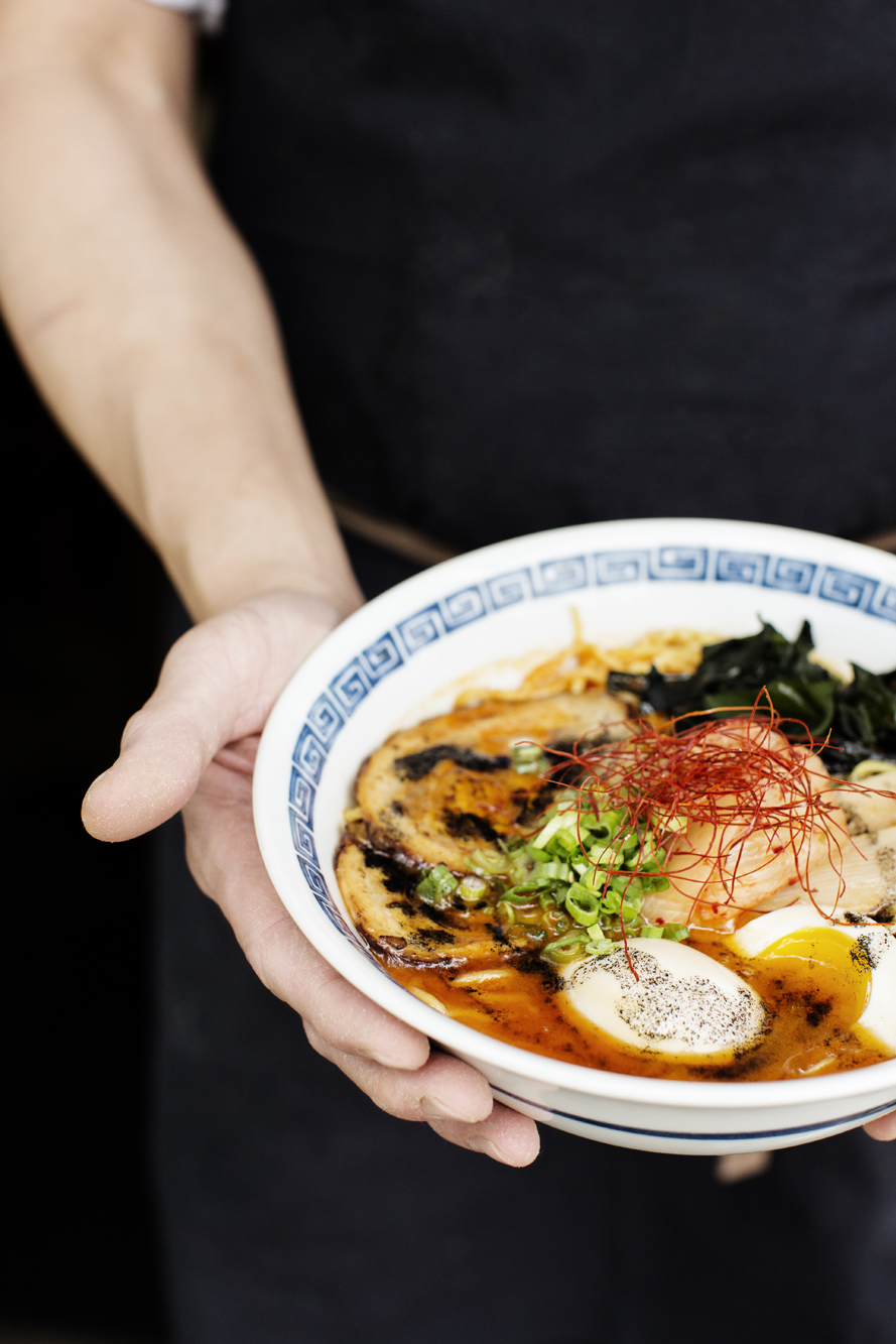 A chef holding a bowl of ramen | Zen Box Izakaya | The Restaurant Project