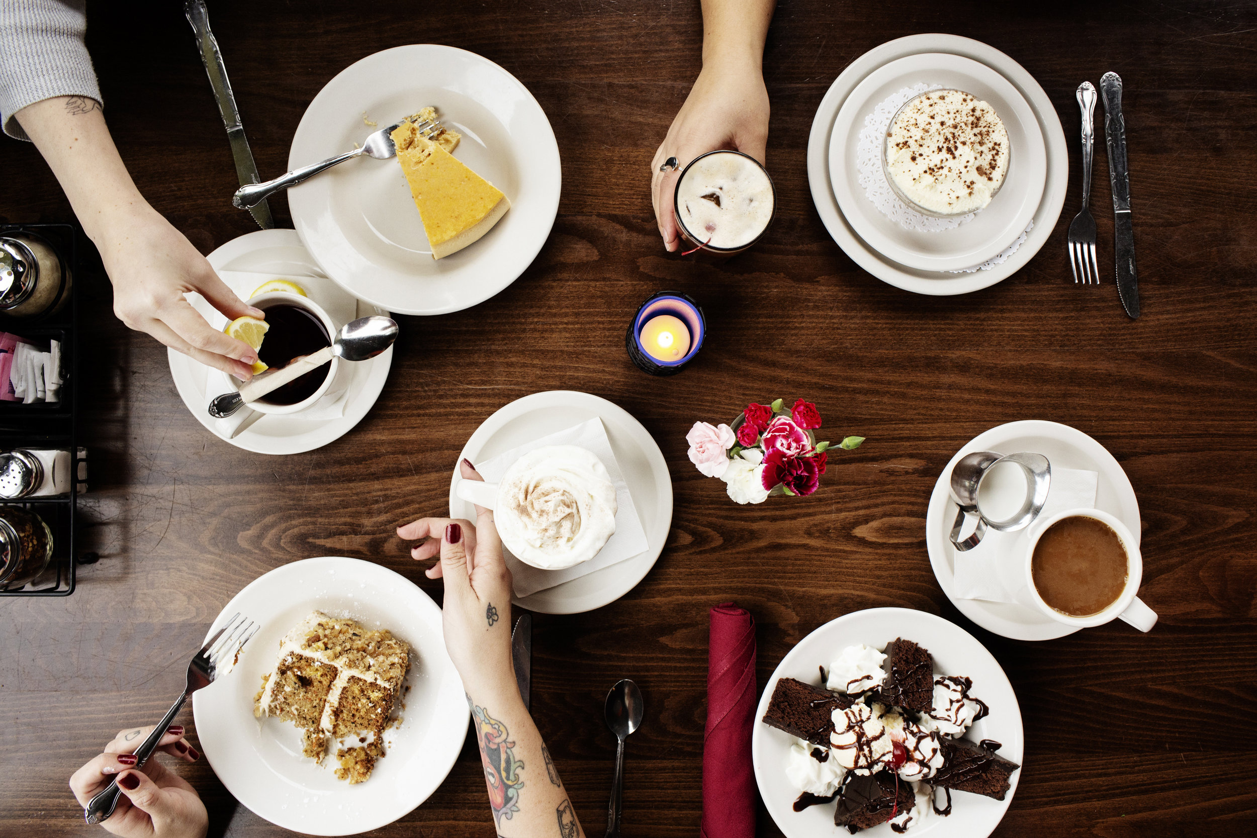 A table full of coffee and desserts | Pizza Lucé | The Restaurant Project