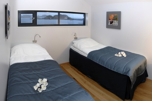You will have your own private twin bedroom with ensuite facilities, with views overlooking the bay.