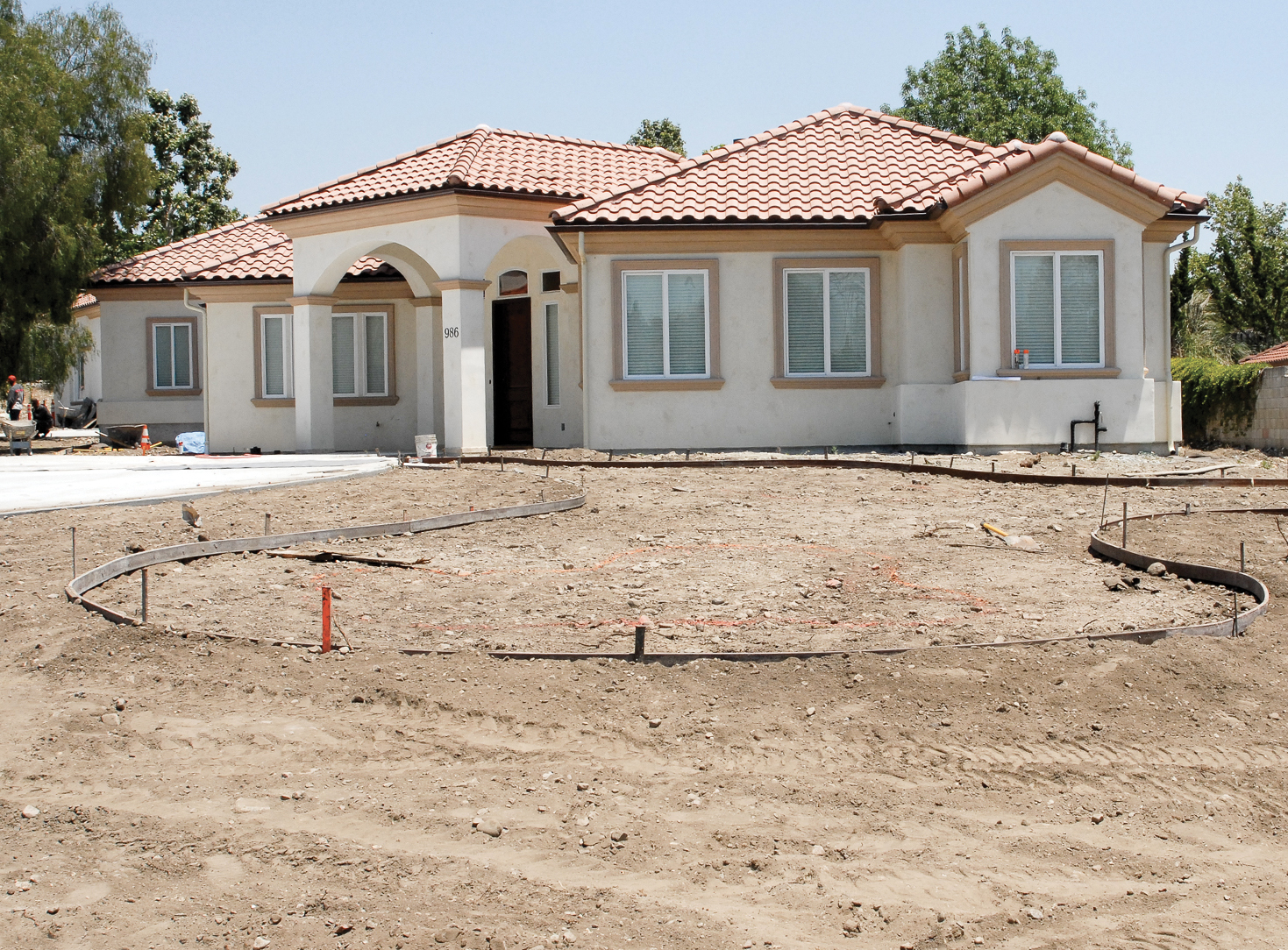 Grade property, prepare soil, and install irrigation.
