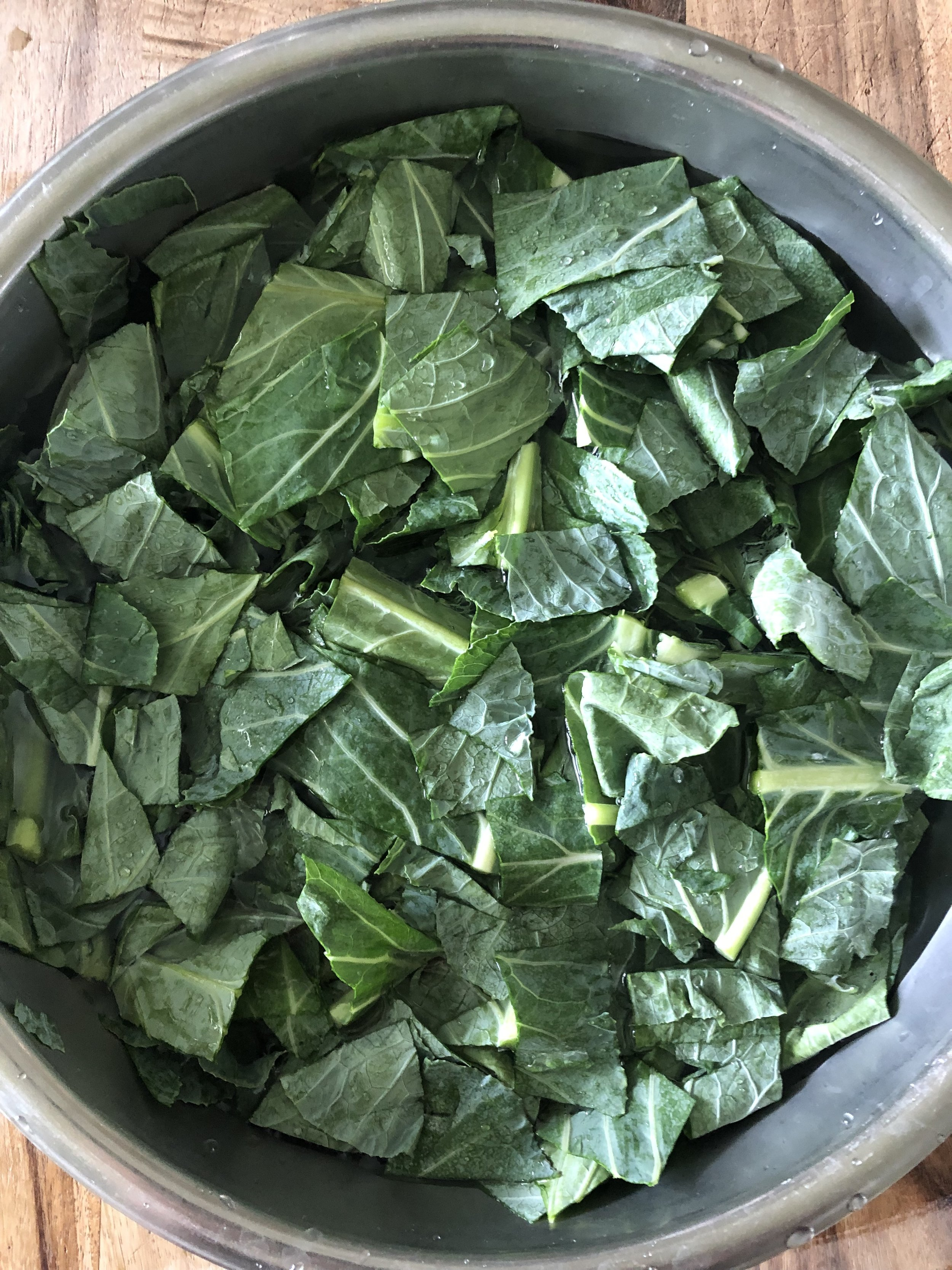 Rinse Collards 3-4 times in water to remove any sand.