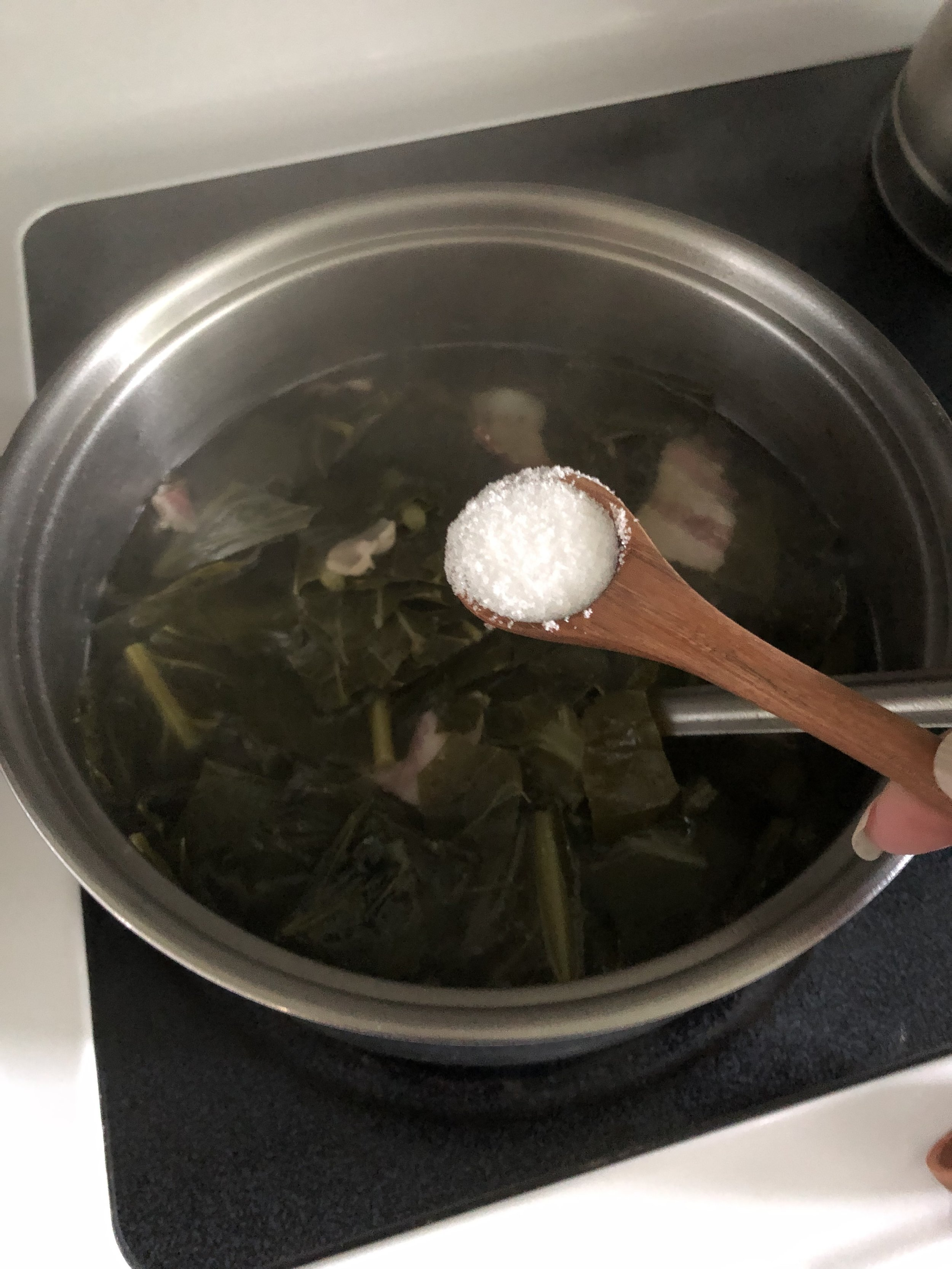 After 4o minutes and while Collards are still on Stove, Add 2 teaspoons Salt, 1/2 teaspooon Pepper, 3 Tablespoons Red Wine Vinegar, 2 - 3 Tablespoons Honey, Continue cooking for an additional 20-25 minutes.